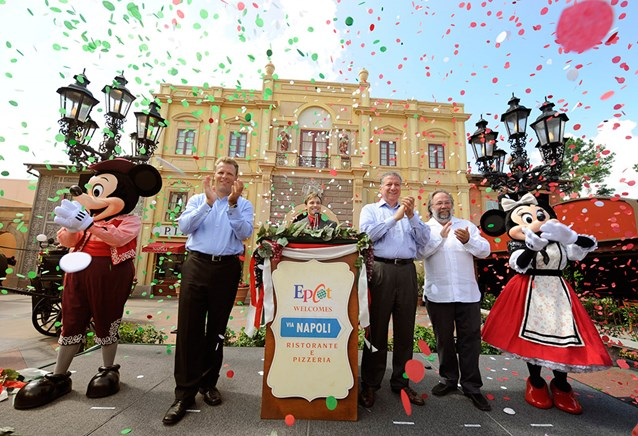 Via Napoli - VIA NAPOLI: (L-R) Mickey Mouse; Dan Cockerell, Vice President of Epcot; Clay Shoemaker, Walt Disney World Ambassador; Nick Valenti, CEO of Patina Restaurant Group; Joachim Splichal, Founder and Chairman of Patina Restaurant Group; and Minnie Mouse celebrate Aug. 5, 2010 during the grand opening of Via Napoli in the Italy pavilion at Epcot World Showcase. Via Napoli, operated by Patina Restaurant Group, features wood-burning ovens – and will use water from a source that most resembles the water in Naples, Italy, home of some of the world's best pizza dough. The 300-seat pizzeria features a menu inspired by the famous pizzerias of southern Italy. The menu also features pastas, salads, sandwiches and Italian wines. (Gene Duncan, photographer)