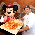 Via Napoli - VIA NAPOLI: Executive Chef Charlie Restivo poses with Mickey Mouse and a special Mickey-shaped pizza Aug. 5, 2010 during the grand opening of the authentic Neapolitan pizzeria in the Italy pavilion at Epcot World Showcase. Via Napoli, operated by Patina Restaurant Group, features wood-burning ovens – and will use water from a source that most resembles the water in Naples, Italy, home of some of the world's best pizza dough. The 300-seat pizzeria features a menu inspired by the famous pizzerias of southern Italy. The menu also features pastas, salads, sandwiches and Italian wines. (Gene Duncan, photographer)