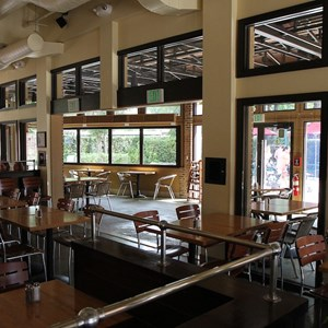 1 of 5: Wolfgang Puck Express - Marketplace - Completed enclosed seating area