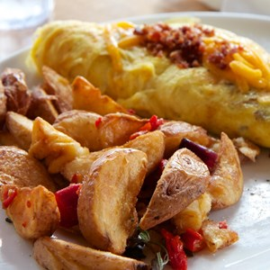 2 of 13: Wolfgang Puck Express - Marketplace - Wolfgang Puck Express Marketplace breakfast - Sausage, Bacon and Cheddar Omelet $13
