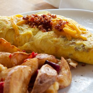 6 of 19: Wolfgang Puck Express - Marketplace - Wolfgang Puck Express Marketplace breakfast - Sausage, Bacon and Cheddar Omelet $13