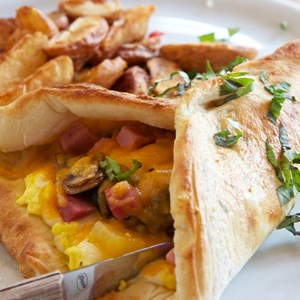 7 of 16: Wolfgang Puck Express - Marketplace - Wolfgang Puck Express Marketplace breakfast - Breakfast Pocket, scrambled eggs, ham, peppers, onions, mushrooms, cheddar $12