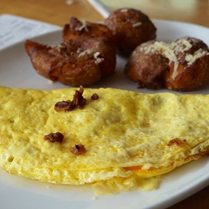 2 of 19: Wolfgang Puck Express - Marketplace - Wolfgang Puck Express Marketplace breakfast - Bacon & Cheddar Omelet with Crispy Potatoes $13.00