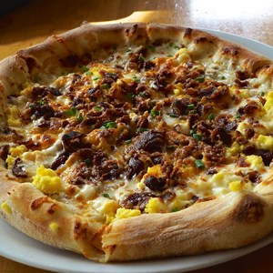 3 of 19: Wolfgang Puck Express - Marketplace - Wolfgang Puck Express Marketplace breakfast - Breakfast Pizza with Egg Whites Scrambled Egg Whites, Bacon, Mozzarella, Cheddar and Carmelized Onions $14.50