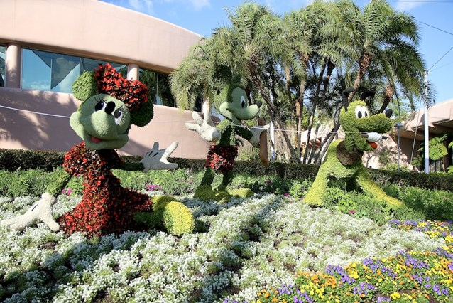 International Flower and Garden Festival - Mickey, Minnie and Pluto kite flying behind Spaceship Earth