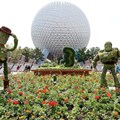 International Flower and Garden Festival - Buzz and Woody infront of Spaceship Earth welcome guests to this year&#39;s festival