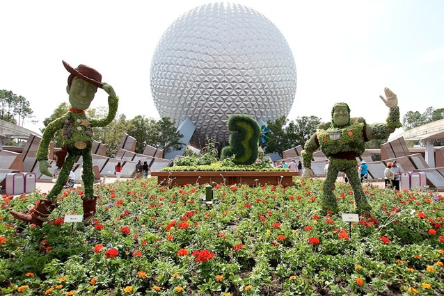 Epcot International Flower and Garden Festival - Buzz and Woody infront of Spaceship Earth welcome guests to this year's festival