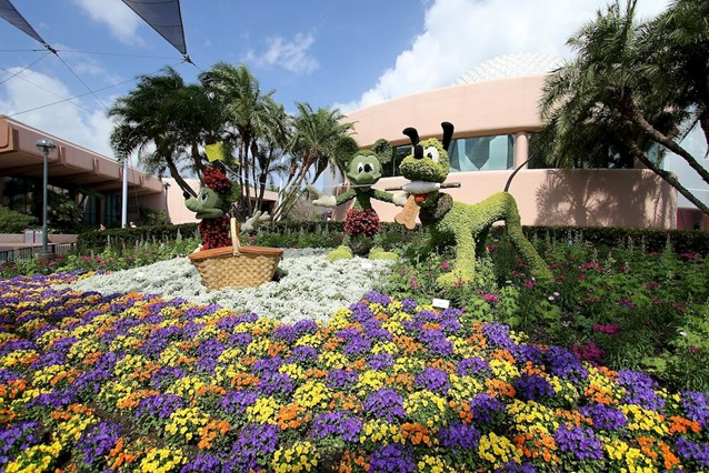 Epcot International Flower and Garden Festival - Mickey, Minnie and Pluto behind Spaceship Earth