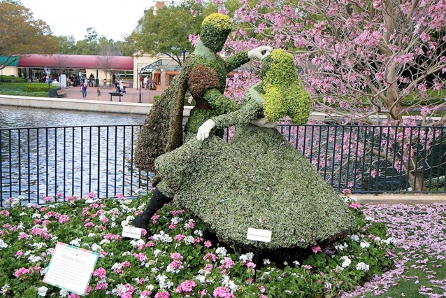 Epcot International Flower and Garden Festival - The Disney Couples topiaries along the bridge from the UK to France