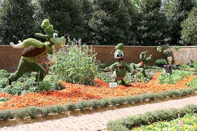 Epcot International Flower and Garden Festival - Goofy, Donald and Pluto in the gardens at the American Adventure Pavilion