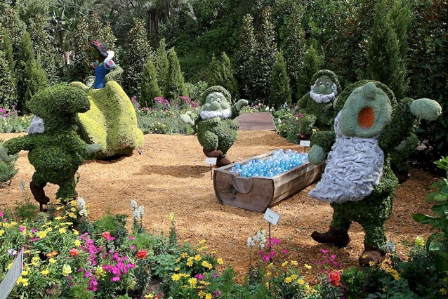Epcot International Flower and Garden Festival - Snow White and the Seven Dwarf topiary at the Germany pavilion