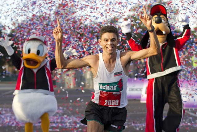 Walt Disney World Marathon Weekend -  Fredison Costa, 33, from Brazil and now living in El Paso, Texas, celebrates Jan. 9, 2011 as he crosses the finish line to win the Walt Disney World Marathon in Lake Buena Vista, Fla. with an unofficial time of 2:21:14