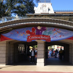 1 of 2: What Will You Celebrate? - Celebrate Today banners in the Magic Kingdom