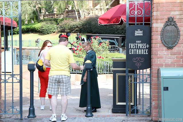 FASTPASS - Guest using FASTPASS+ RFID reader at the Haunted Mansion