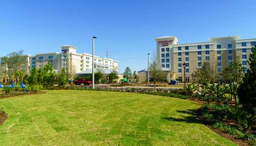 Flamingo Crossing hotels SpringHill Suites and TownePlace Suites will offer transport to the parks and a Disney Planning Center