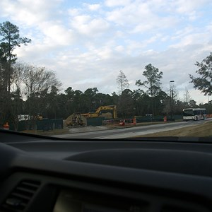 1 of 6: Kennels - The construction site is ahead on the left, the turn for Port Orleans Riverside is immediately to the right of the vehicle