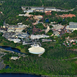 1 of 11: Walt Disney World Aerial Photos - The Magic Kingdom viewed from the east (behind Bay Lake Tower). The main entrance turnstyles are to the left and Fantasyland is to the right.