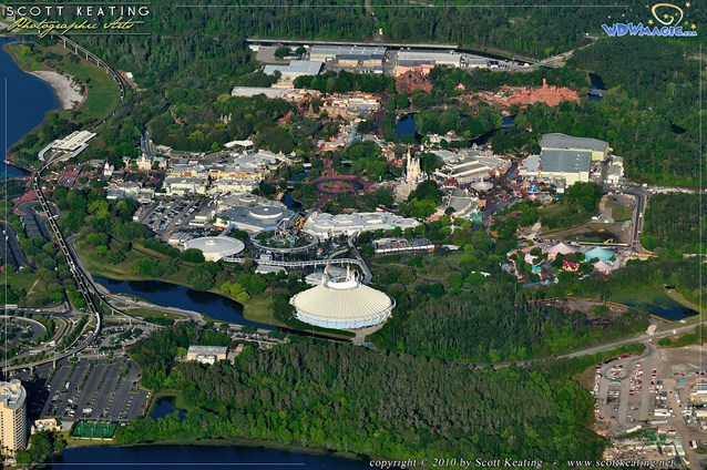 Walt Disney World Aerial Photos - The Magic Kingdom viewed from the east (behind Bay Lake Tower). The main entrance turnstyles are to the left and Fantasyland is to the right.