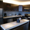 Bay Lake Tower at Disney's Contemporary Resort - The kitchen area in a 3 bedroom, 2 story grand villa