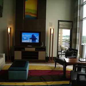 10 of 38: Bay Lake Tower at Disney's Contemporary Resort - The Grand Villa living room with view out to Bay Lake