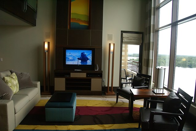 Bay Lake Tower at Disney's Contemporary Resort - The Grand Villa living room with view out to Bay Lake