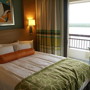 16 of 38: Bay Lake Tower at Disney's Contemporary Resort - One of the queen beds in a second story bedroom of the Grand Villa