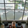Bay Lake Tower at Disney&#39;s Contemporary Resort - The view from the split level second story down into the living room and out onto Bay Lake and the Contemporary marina
