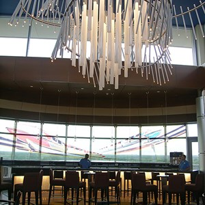25 of 38: Bay Lake Tower at Disney's Contemporary Resort - Original Mark I monorail concept art provides the backdrop to the lounge bar area