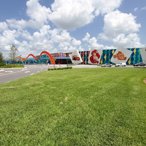 3 of 44: Disney's Art of Animation Resort - Main entrance area, bus stops to the left, arriving guests drop-off to the right