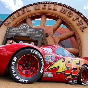 28 of 33: Disney's Art of Animation Resort - Lightning McQueen in front of the Wheel Well Motel building in Cars section at Disney's Art of Animation Resort