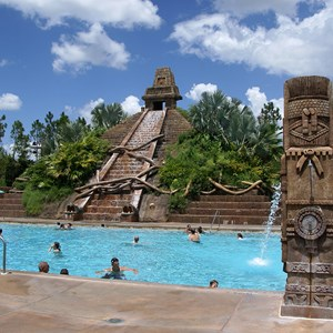 2 of 14: Disney's Coronado Springs Resort - The Lost City of Cibola pool with the Jaguar Slide splash-down on the far right