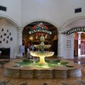 Disney&#39;s Coronado Springs Resort - El Centro lobby area looking towards the gift shop and restaurant areas