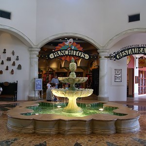 6 of 16: Disney's Coronado Springs Resort - El Centro lobby area looking towards the gift shop and restaurant areas