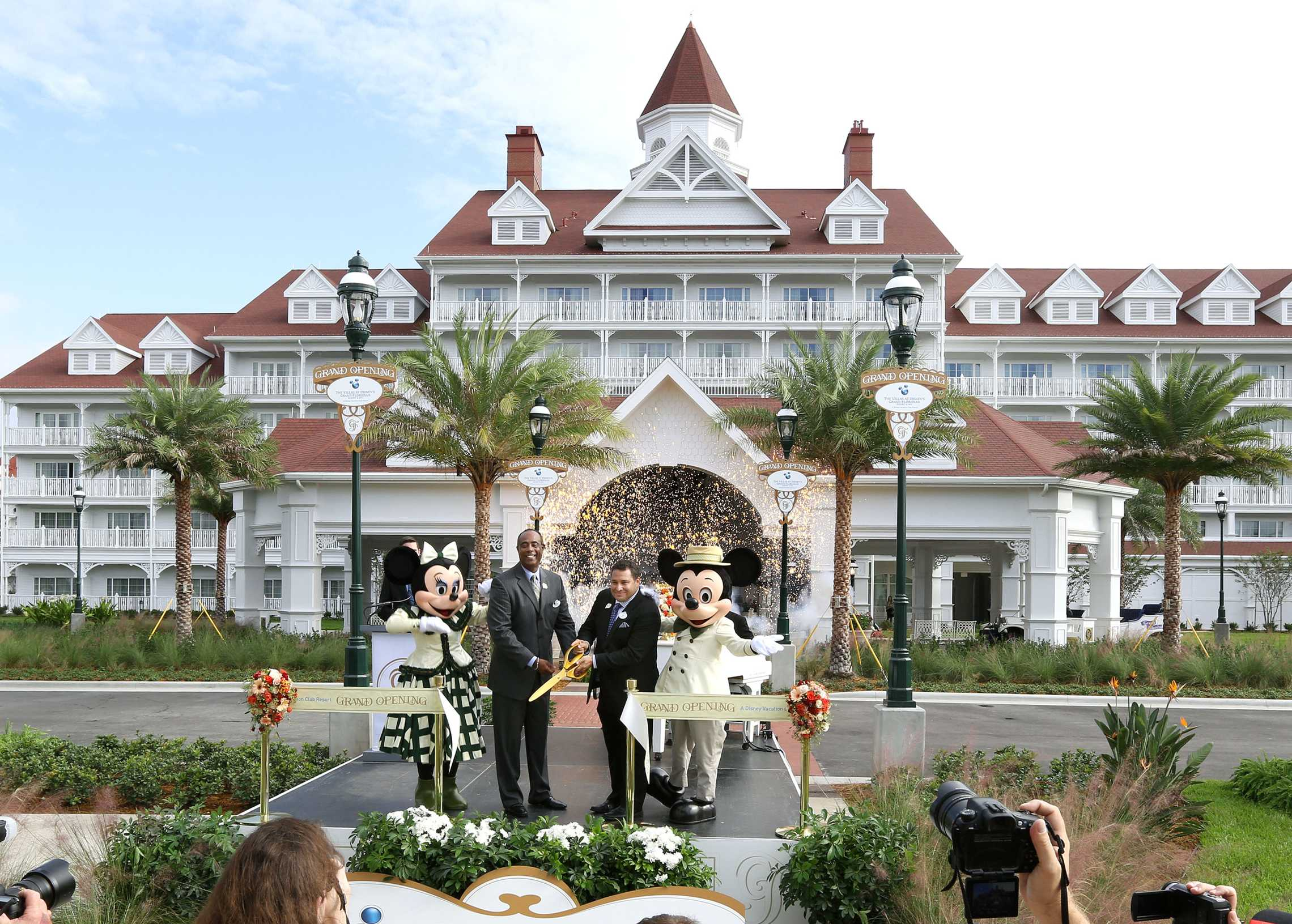 Ken Potrock, Norm Noble at the new Villas at Disney's Grand Floridian Resort joined Mickey and Minnie Mouse to celebrate the grand opening