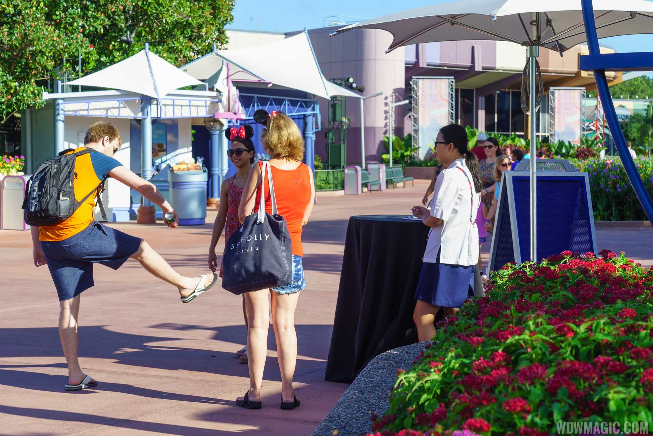 Guests making use of the complimentary insect repellent at Epcot