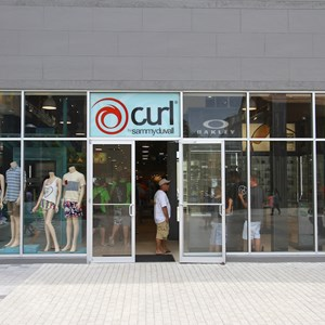 3 of 12: Curl by Sammy Duvall - Curl by Sammy Duvall in new location at Downtown Disney West Side - Entrance