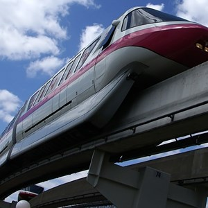 1 of 2: Walt Disney World Monorail System - Monorail Pink leaving the Magic Kingdom on the Resort Line March 2009.