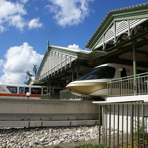 3 of 4: Walt Disney World Monorail System - Monorail Orange leaving the station on the Resort Line